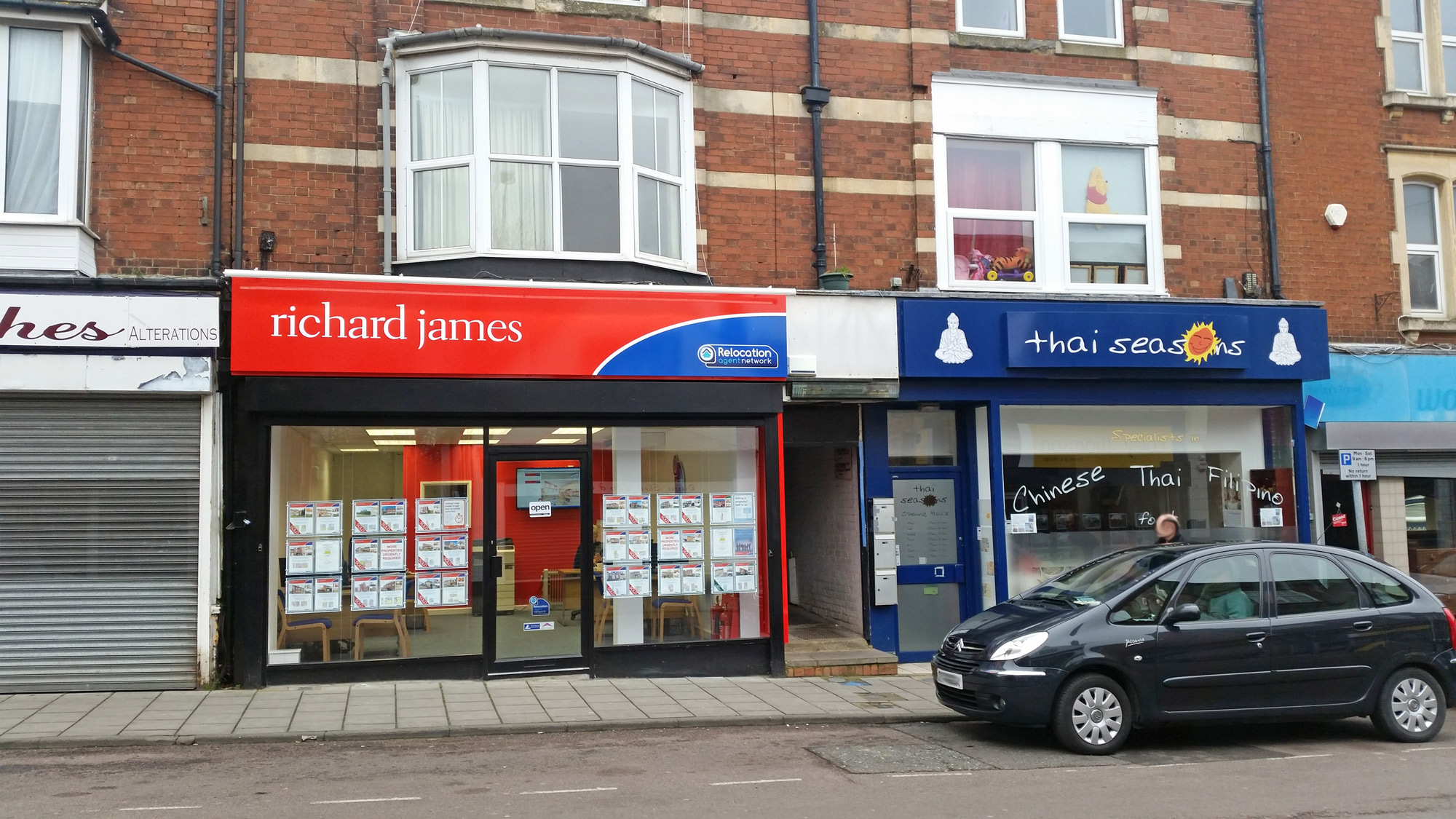 Richard James Estate Agents at 74 High Street, and next door, Thai Seasons at number 72. February 2016.